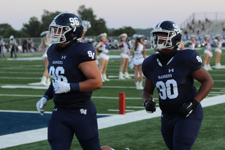 Defensive tackles Luke Seminaro (left) and Jordan Thompson warm up before a game. The defensive line will have its hands full on Thursday against New Braunfels and running back Ryker Purdy (580 yards, 8 touchdowns).