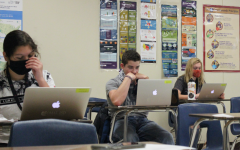 Halfway through their second period U.S. government class, seniors Zach Santana and Hadley Thomas research for their projects.
