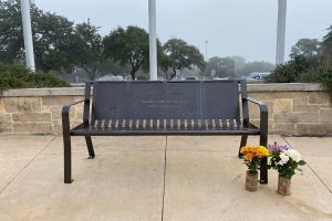 Former students Kayleigh Klinksiek and Rebekah Mann placed flowers next to Stacie Younts' bench in honor of their teacher's death. The flower vases were made by Klinksiek's dad.