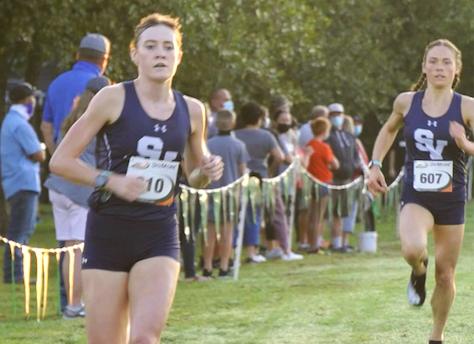 Sara Scott takes the lead at the Cedar Park Invite, Amalie Mills close behind.