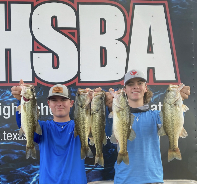 Junior Mason McClellan and sophomore Ryder Cunningham showoff the day's catch.
