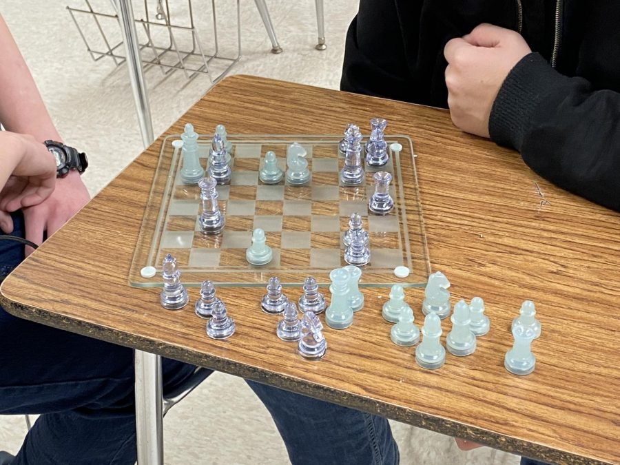 Two kids playing in chess club.