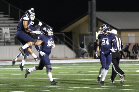 Luke Seminaro (96) celebrates a sack with his teammates. The defense will have their hands full this week against Judson
