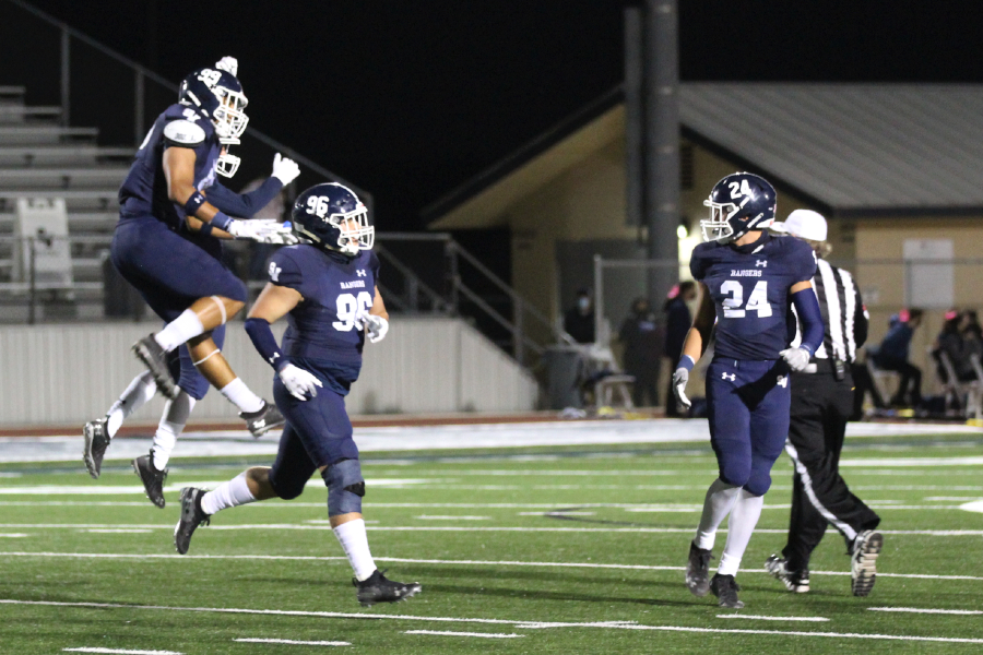 Luke Seminaro (96) celebrates a sack with his teammates. The defense will have their hands full this week against Judson's dynamic offense.