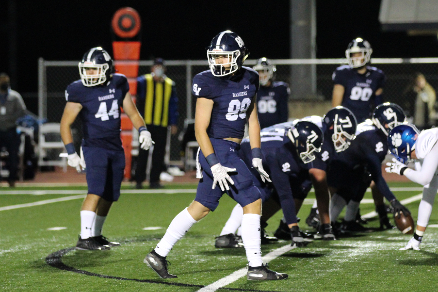 The+offense+looks+to+the+sideline+for+the+play.+The+Rangers+put+up+their+second-highest+point+total+this+season+against+rival+Judson+on+Friday.