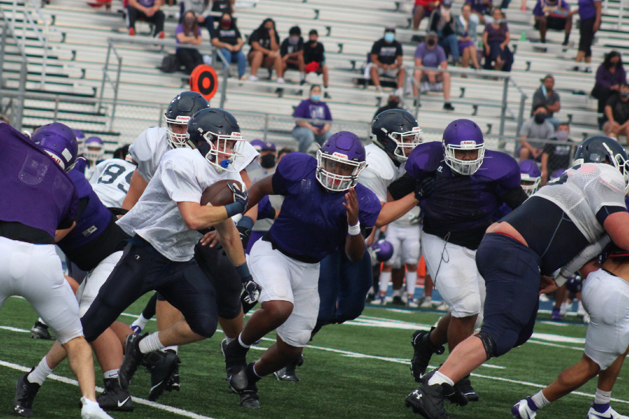 The offense runs the ball during a preseason scrimmage against San Marcos. This season, the Rangers ran for 1,895 yards and 31 touchdowns.