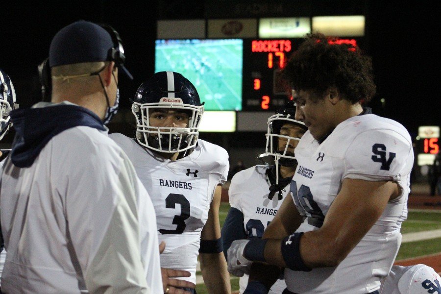 Defensive+linemen+Diego+Hamilton+%28left%29+and+Trey+Moore+%28right%29+discuss+tactics+on+the+sideline.+The+defense+will+have+their+hands+full+Friday+against+a+Westlake+team+averaging+54.9+points+per+game.