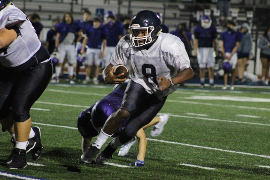 Jalen Nutt weaves through the San Marcos defense. Nutt has compiled 1,661 total yards and 17 touchdowns in his first season as a varsity quarterback.