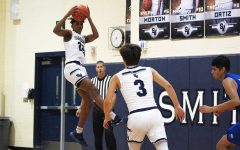 During district play Jan. 8 at home, junior Tevijon Williams pulls down a rebound against South San before senior Cody Garcia make his move down the court. Williams led all scorers with 14 points.