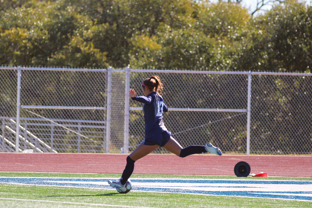Sophomore Kaili Castillo takes a free kick from the Rangers' defensive third. The girls won all three games in their Ranger Classic tournament, bonding as a team before district play.