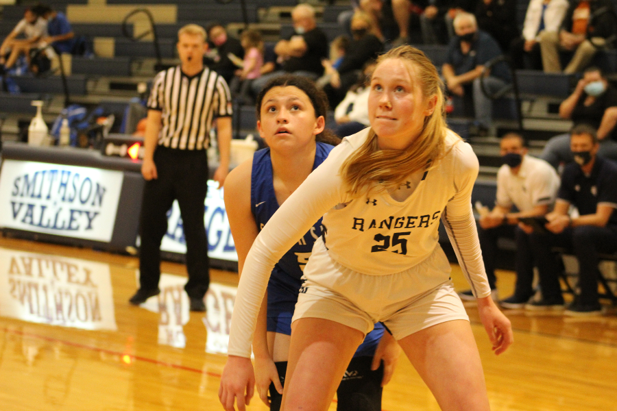 Junior Gabby Elliot shields her South San opponent as she waits for the rebound. Elliot scored 11 points in the Rangers 56-40 loss to the Bobcats.