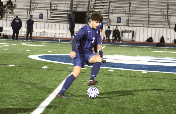 Captain Devin Yocham takes the ball down the field in the Ranger's game against Clemens. The Buffs won 2-1 and stand at first in the district.
