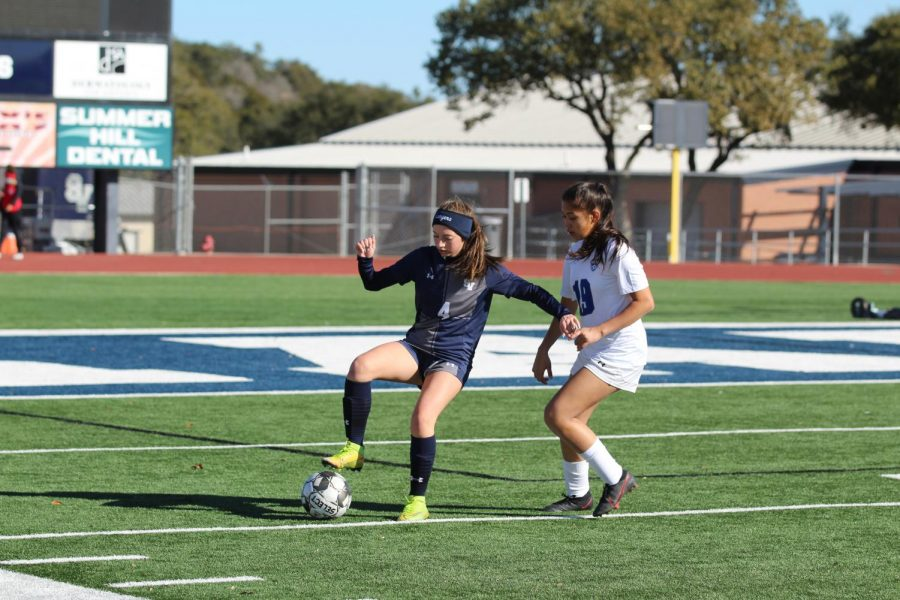 Chloe Berry battles for the ball against the McCarthur Brahmas