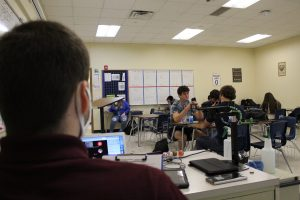 Math teacher Troy Wyant instructs his second period students both online and face-to-face.
