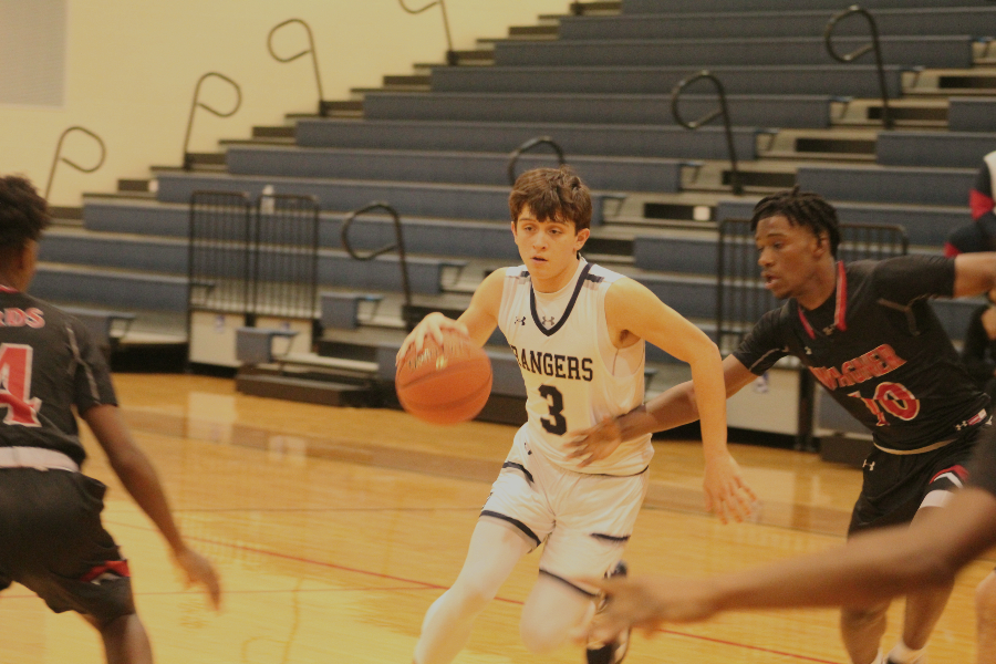 Senior Cody Garcia maneuvers around two Wagner defenders. Garcia averaged 7.7 points per game this season and led the team in assists.