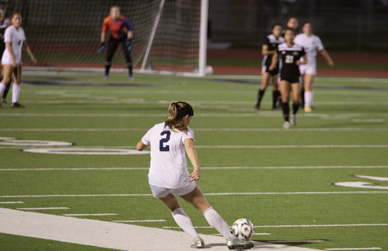 Senior Helene Farris takes a free kick in the district championship against Steele. Farris committed to play soccer at UTSA last month, and this year is her first at Smithson Valley.