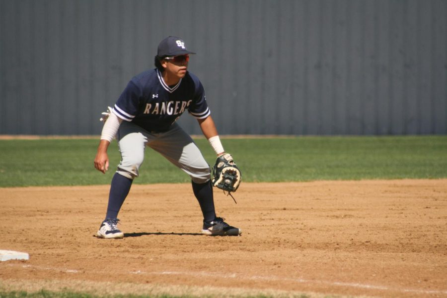John Garza prepares to charge a ground ball. Garza, a breakout third baseman, has played a key role in baseball's 11-game winning streak.
