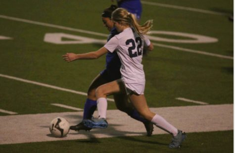 Sophomore Malia Thalman fights for possesion at South San on March 3. Against the Bobcats, Thalman scored one goal and had two assists.