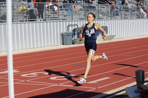 Running in the 4X400 relay, senior Amalie Mills takes her strides to the finish line. At the Ranger Relays, she ran the relay after running the mile. The girls  4x400 m relay placed first in the Brenham meet with a time of 4:05.