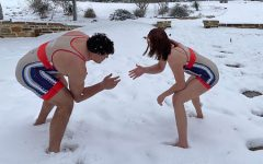 Siblings Ryan and Sage Benca square off in the snow. Both compete for the schools wrestling team.