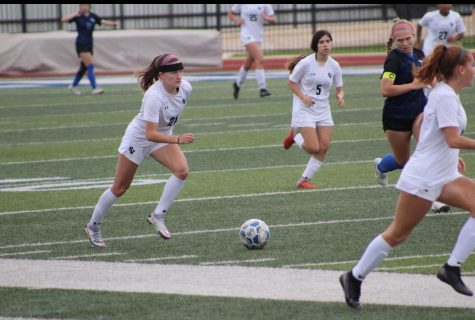 Senior Jewel Mann takes the ball down the field against New Braunfels.  Mann has 14 goals and 10 assists this season.