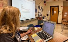 AP English III teacher Verna Mann presents the class assignment via projector for face-to-face students and shares her laptop screen on Google Meets for remote students.