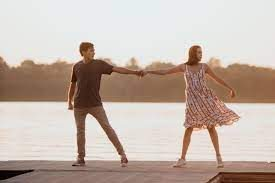 During one of the many musical numbers, Will and Avery are romantically dancing on the deck of the camp pier.