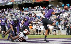 Toe-tapping in the back of the end zone, Trevon Moehrig tips an interception to himself. Moehrig, a Smithson Valley alum, is widely expected to be selected in the first round of this weekends NFL draft.