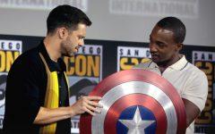 Sebastian Stan (Bucky Barnes) and Anthony Mackie (Sam Wilson) hold Captain Americas vibranium shield. Steve Rogers passed the shield to Wilson in the last Avengers film.