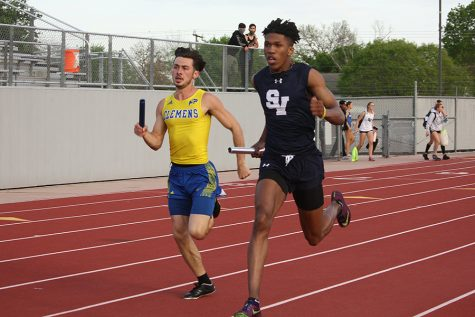 Tevijon Williams races against Clemens at the district track meet. Williams, who is competing with the 4x400 relay this weekend, holds the school record for the 100m (10.55).