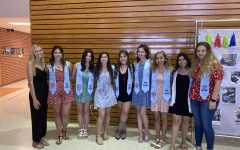 Valerie Grona (far left) meets with other 'Ready Set Teach' graduates May 5 in the senior dining hall.