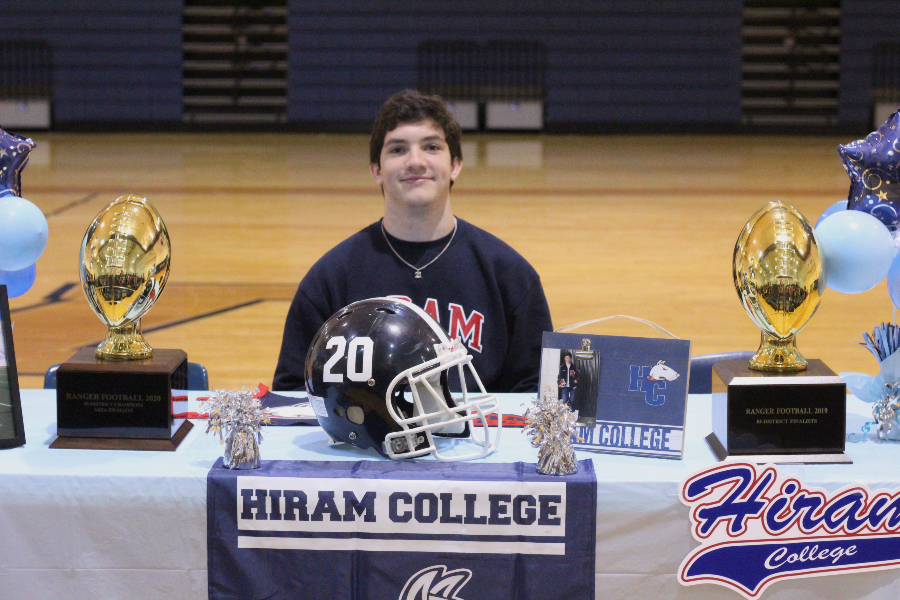 Gabe Hoskins signed to attend Hiram College to continue his football career.