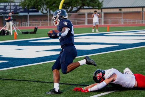 Malachi Lane rumbles into the end zone for a 61-yard touchdown on Friday against Wagner. Lane also blocked a punt a recovered a fumble, which he returned for another score, in footballs 42-14 win over the Thunderbirds.