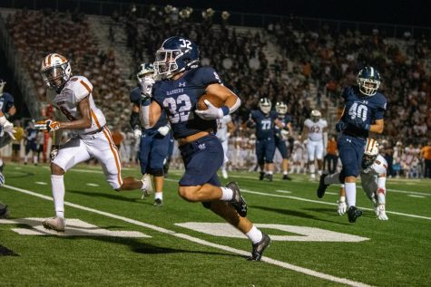 Travis McCracken sprints for a first down against Madison on Sept. 3. McCracken rushed for 154 yards and 2 touchdowns on Friday against El Paso Eastwood.