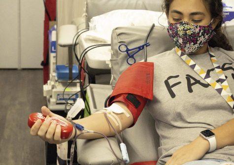 Former student, Katelyn Obregon, giving blood.