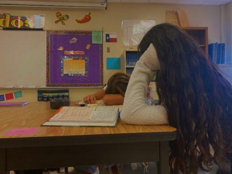 Juniors Valerie Mendez and Jordan Jones slump over their Spanish textbooks.