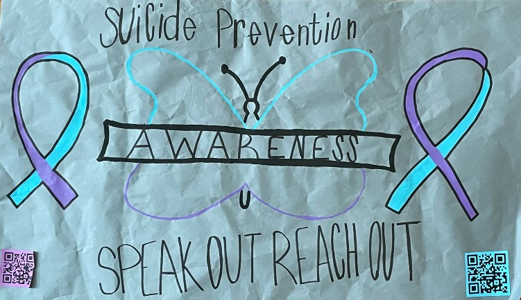 Suicide awareness posters are located around the school with QR codes for students looking for help.
