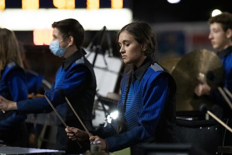 During halftime in the New Braunfels game Sept. 23, the drum line performs its competition show.
